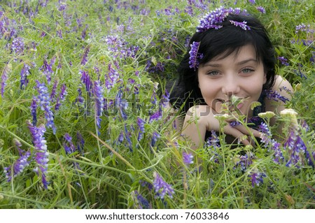 Beautiful Black Hair Girl in flowers - stock photo