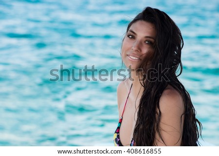 beautiful black hair mexican woman on the sea background