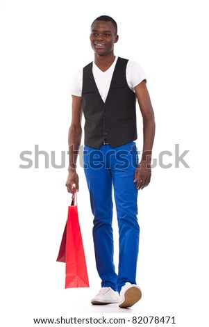 beautiful black man holding shopping bags and smiling - stock photo