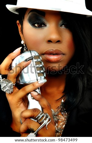 Beautiful Black Musician Singing Into Microphone - stock photo