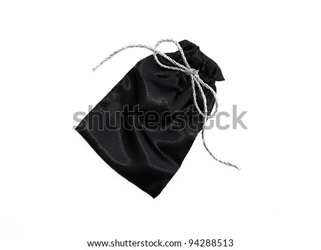 Beautiful Black Silk Pouch / Bag to hold Jewelry and Delicate items isolated on White Background - stock photo
