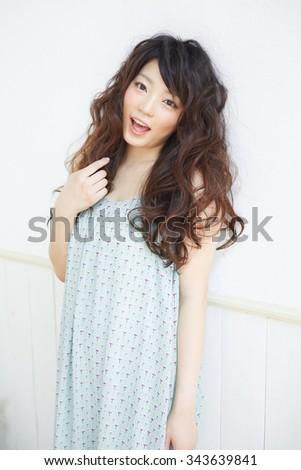 Beautiful black woman. Curly Long Hair. - stock photo