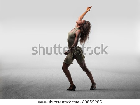 Beautiful black woman dancing - stock photo