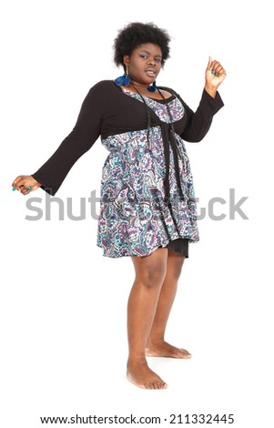 Beautiful black woman doing different expressions in different sets of clothes: dancing - stock photo