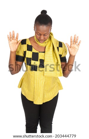 Beautiful black woman doing different expressions in different sets of clothes: praying - stock photo