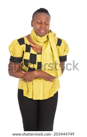 Beautiful black woman doing different expressions in different sets of clothes: stomachache - stock photo