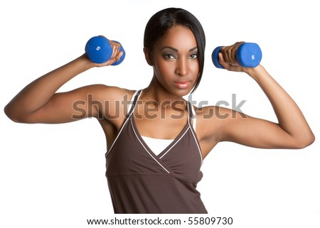 Beautiful black woman exercising - stock photo