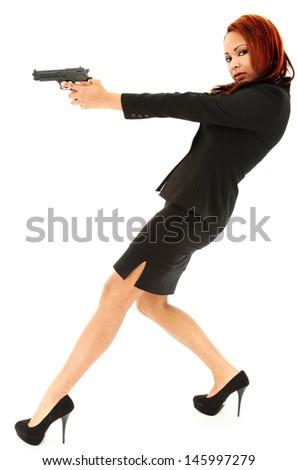 Beautiful Black Woman in Suit and Heels aiming handgun. - stock photo