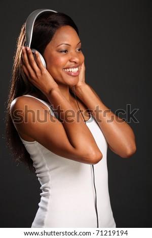 Beautiful black woman music fan happy smile - stock photo