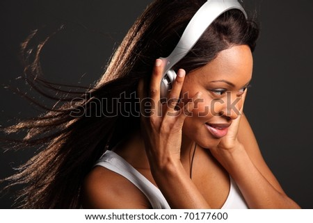 Beautiful black woman music lover listening - stock photo