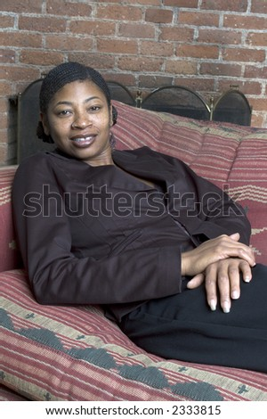 beautiful black woman on sofa relaxing sexy