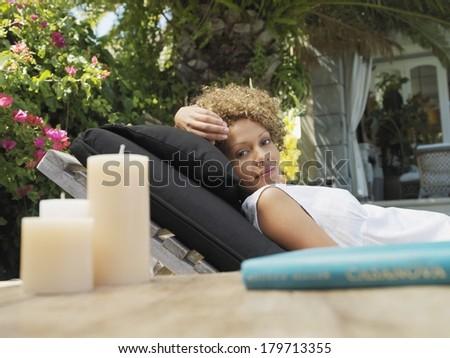 Beautiful black woman relaxing - stock photo