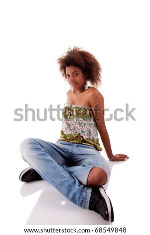 beautiful black  woman, sitting on the floor, isolated on white background - stock photo