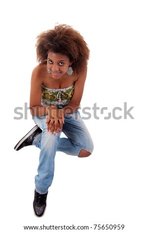 beautiful black  woman, sitting on the floor looking up, isolated on white background