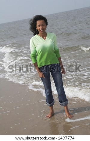 beautiful black woman standing by the waterside