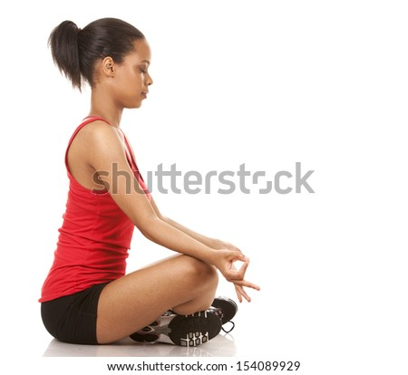 beautiful black woman wearing red fitness outfit on white background - stock photo