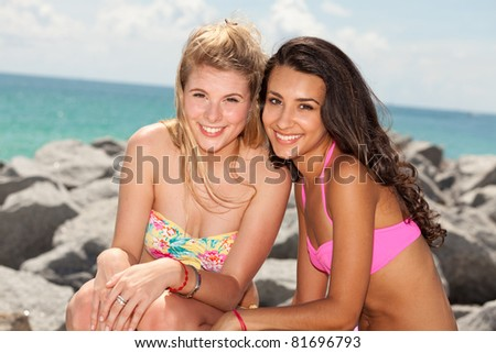 Beautiful blond and brunette young women enjoying South Beach in Miami. - stock photo