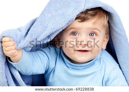 Beautiful blond baby with a towel isolated on white background - stock photo