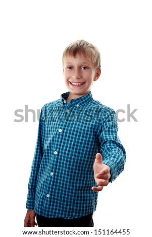Beautiful blond boy in a blue shirt smiles happily and shows a greeting gesture stretching out his left hand (isolated on white background) - stock photo