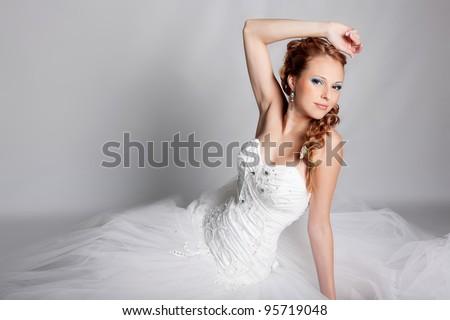 Beautiful blond bride photo in studio - stock photo