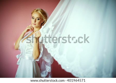 Beautiful blond bride possing at home