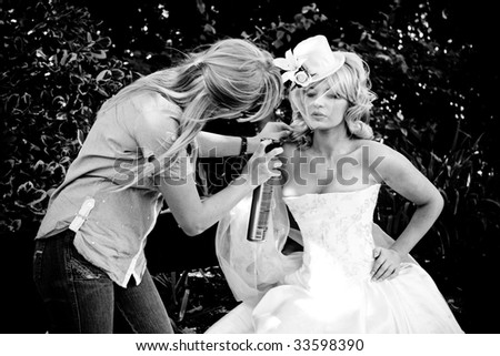 Beautiful blond bride preparing for the wedding and make-up - stock photo