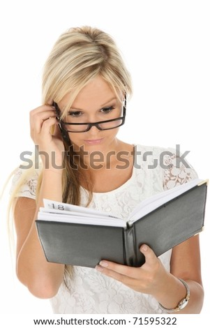 Beautiful blond business woman checking her diary - stock photo