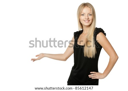 Beautiful blond business woman in black dress showing copy space over white background