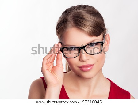 Beautiful blond business woman in modern eyeglasses. Young attractive Caucasian female model wearing optical glasses in black frame.  - stock photo