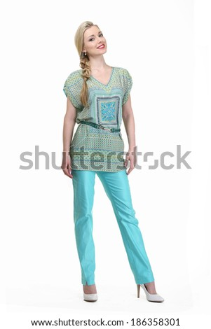 beautiful blond fashion business woman model in aquamarine trousers and blouse isolated on white