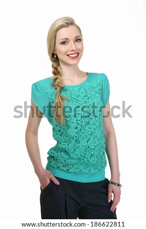 beautiful blond fashion business woman model in green sleeveless t-shirt isolated on white