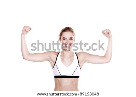 Beautiful blond fitness woman showing off her arms. Fitness woman.