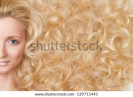 Beautiful Blond Girl. Healthy Long Curls Hair - stock photo