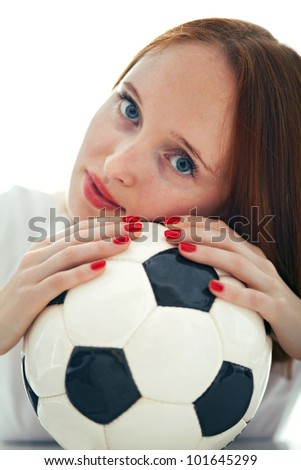 Beautiful blond girl holding a soccer ball isolated on the white background