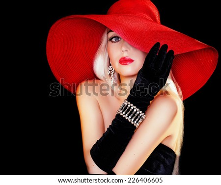 beautiful blond girl in a hat . - stock photo