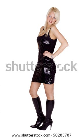 Beautiful blond girl in a party dress - stock photo