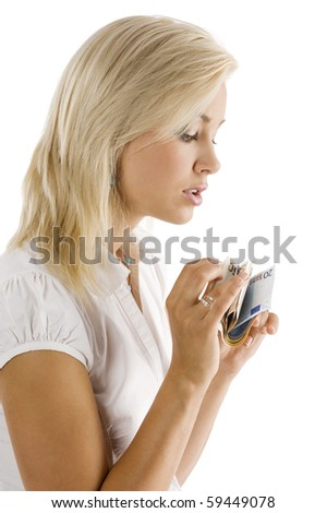 beautiful blond girl in act to count some euro cash from her hands - stock photo