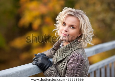 Beautiful blond girl in autumn walk - stock photo