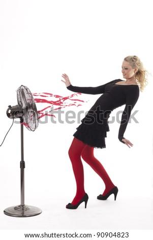 Beautiful blond girl in black dress with fan - stock photo