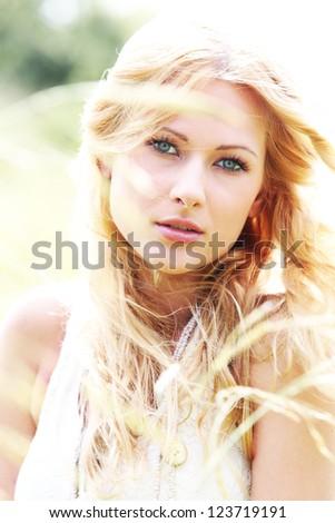 Beautiful blond girl in meadow - stock photo