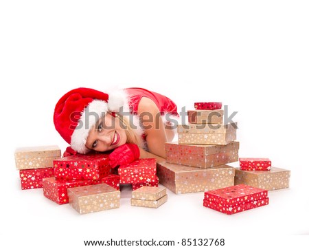 Beautiful blond girl in Santa costume with Christmas gifts, isolated on white background - stock photo