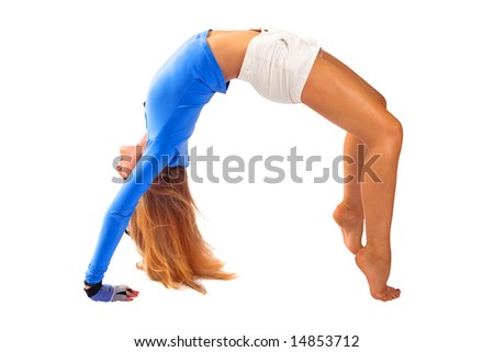 Beautiful blond girl in tension in gymnastic pose - stock photo
