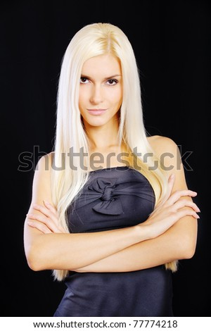 Beautiful blond girl, isolated on black background.