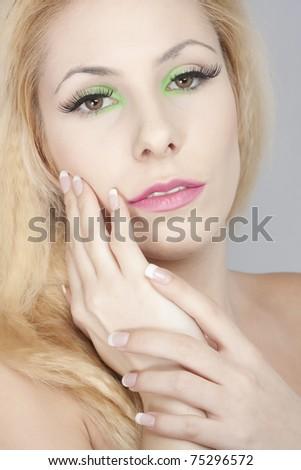 beautiful blond girl, joyful colorful makeup - stock photo
