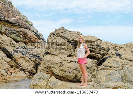 Beautiful blond girl  on the beach - stock photo