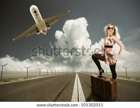 Beautiful blond girl posing on runway, concept of travel. In retro design - stock photo