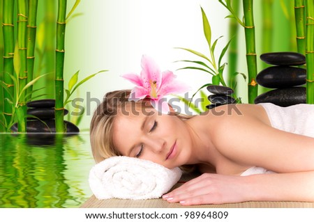 Beautiful blond girl relaxing, concept of spa - stock photo