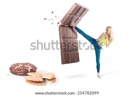 Beautiful blond girl resist temptation and fight back bad habbits, no to junk food - stock photo