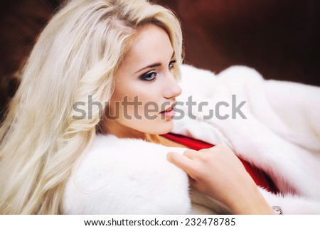 Beautiful blond girl wearing White Fur Coat - stock photo
