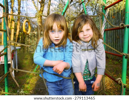beautiful blond girl with blue eyes foreshorteniing outdoor summer portrait - stock photo